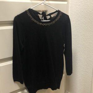 Black sweater with decorative neckline